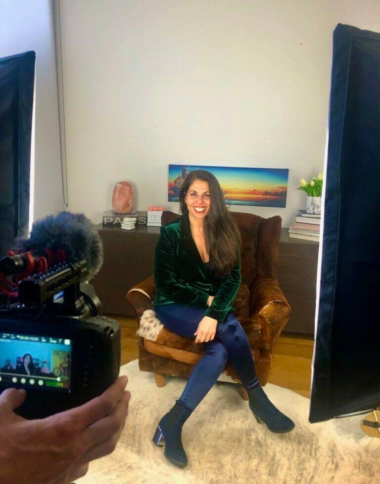 Tammy Hamawi seated with camera